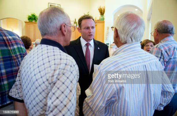 Patrick Murphy democratic candidate in Florida's 18th District talks with constituents during a meet and greet at the home of Michael and Jill Buzzeo...