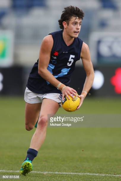 Patrick Naish of Vic Metro runs with the ball during the U18 AFL Championships match between Vic Metro and the Allies at Simonds Stadium on July 5...