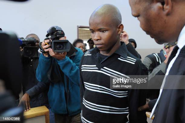 Patrick Ndlovu appears on trail at the Ventersdorp magistrates court on May 22 2012 in Ventersdorp South Africa Ndlovu and Chris Mahlangu are accused...