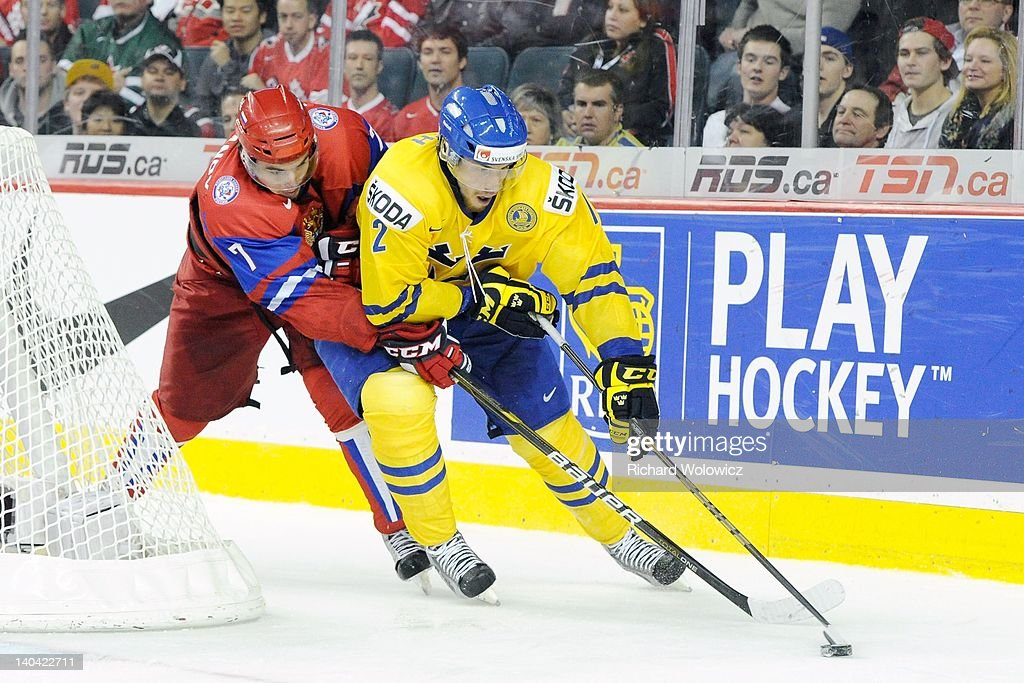Patrick Nemeth #12 of Team Sweden skates with the puck while being defended by Igor Ozhiganov #7 of Team Russia during the 2012 World Junior Hockey Championship Gold Medal game at the Scotiabank Saddledome on January 5, 2012 in Calgary, Alberta, Canada. Team Sweden defeated Team Russia 1-0 in overtime.