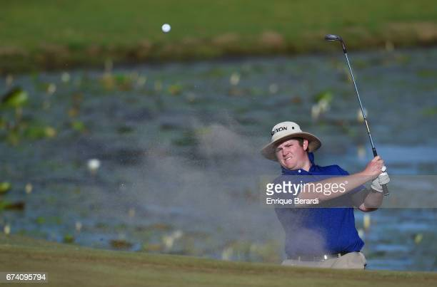 Patrick Newcomb of the United States hits out of a bunker on the 18th hole during the final round of the PGA TOUR Latinoamérica Honduras Open...