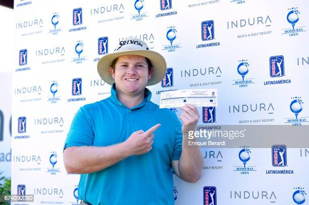 Patrick Newcomb of the United States holds his scorecard with the course record during the third round of the PGA TOUR Latinoamérica Honduras Open...