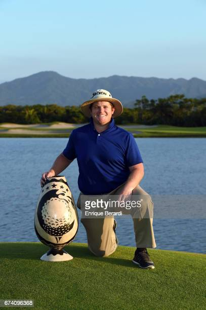 Patrick Newcomb of the United States poses with the tournament trophy after his victory at the final PGA TOUR Latinoamérica Honduras Open presented...