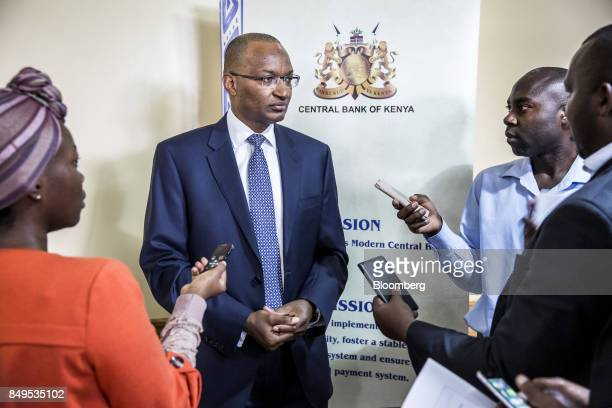 Patrick Njoroge governor of Kenya's central bank speaks to journalists following a news conference at the central bank headquarters in Nairobi Kenya...