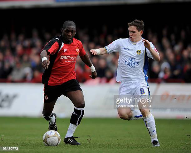 Patrick Noubissie of Kettering Town and Neil Kilkenny of Leeds United challenge for the ball during the FA Cup 2nd Round match between Kettering Town...