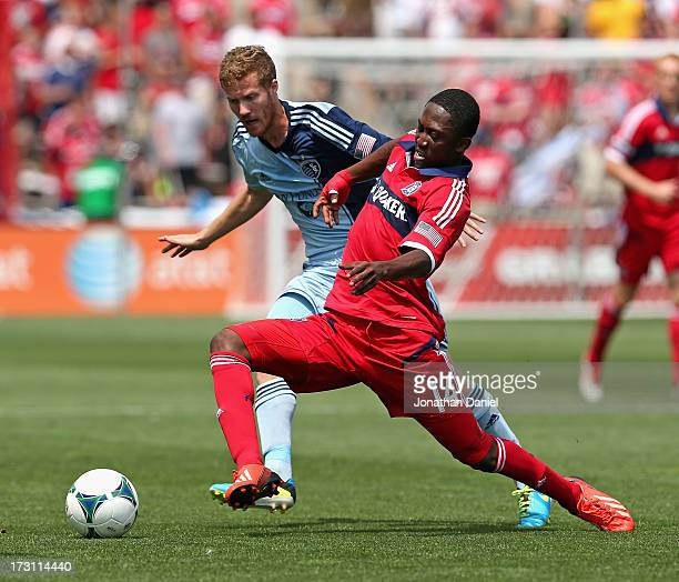Patrick Nyarko 14 of the Chicago Fire tries to hold off Oriol Rosell of Sporting Kansas City during an MLS match at Toyota Park on July 7 2013 in...