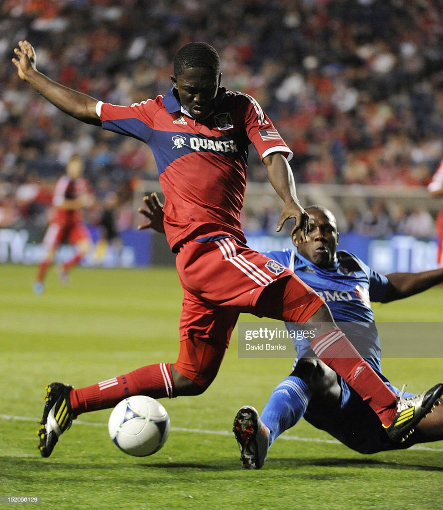 Patrick Nyarko #14, left, of Chicago Fire and Nelson Rivas #2 of Montreal Impact vie for the ball in an MLS match on September 15, 2012 at Toyota Park in Bridgeview, Illinois.