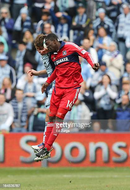 Patrick Nyarko of Chicago Fire and Matt Besler of Sporting Kansas City collide as they go up for the ball at Sporting Park on March 16 2013 in Kansas...