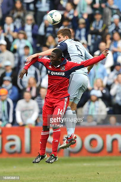 Patrick Nyarko of Chicago Fire heads the ball away from Matt Besler of Sporting Kansas City in the first half at Sporting Park on March 16 2013 in...