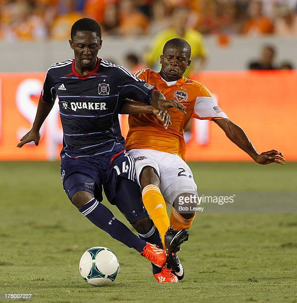 Patrick Nyarko of Chicago Fire is marked by Boniek Garcia of Houston Dynamo at BBVA Compass Stadium on July 27 2013 in Houston Texas