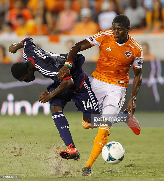 Patrick Nyarko of Chicago Fire is run off the ball by Kofi Sarkodie of Houston Dynamo at BBVA Compass Stadium on July 27 2013 in Houston Texas