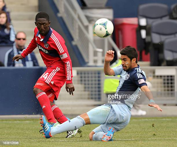 Patrick Nyarko of Chicago Fire passes the ball past Paulo Nagamura of Sporting Kansas City in the second half at Sporting Park on March 16 2013 in...