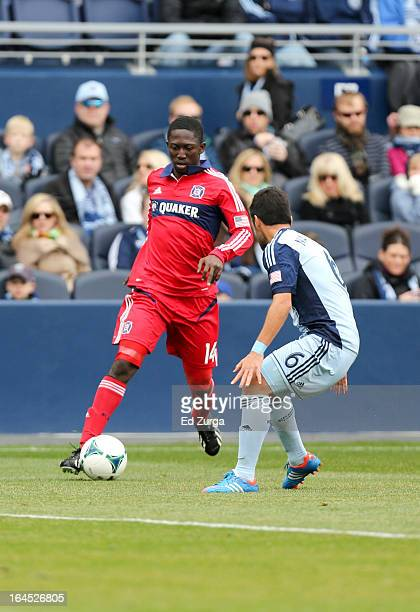 Patrick Nyarko of Chicago Fire works the ball against Paulo Nagamura of Sporting Kansas City in the second half at Sporting Park on March 16 2013 in...