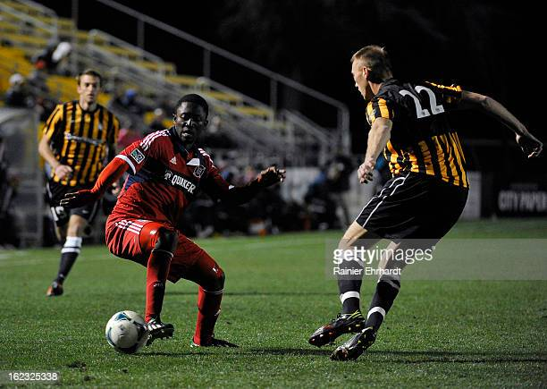 Patrick Nyarko of the Chicago Fire and Cody Ellison of the Charleston Battery battle for the ball during the first half of a game at Blackbaud...