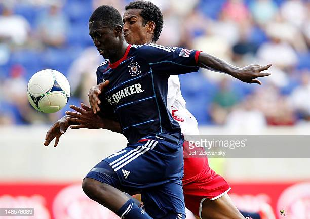 Patrick Nyarko of the Chicago Fire and Roy Miller of the New York Red Bulls chase the ball during their match at Red Bull Arena on July 18 2012 in...