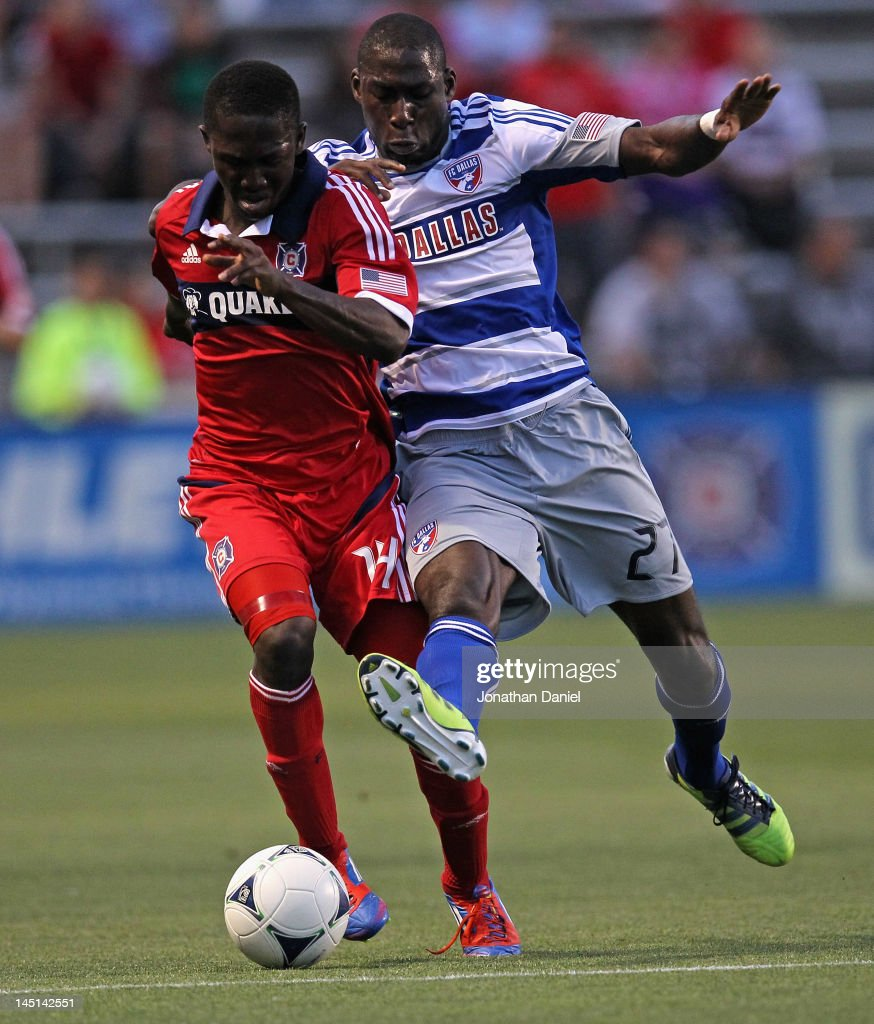 Patrick Nyarko #14 of the Chicago Fire battles for the ball with James Marcelin #27 of FC Dallas during an MLS match at Toyota Park on May 23, 2012 in Bridgeview, Illinois.
