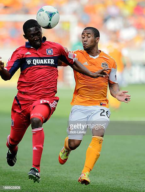 Patrick Nyarko of the Chicago Fire heads the ball as he is pressured by Corey Ashe of the Houston Dynamo at BBVA Compass Stadium on April 14 2013 in...