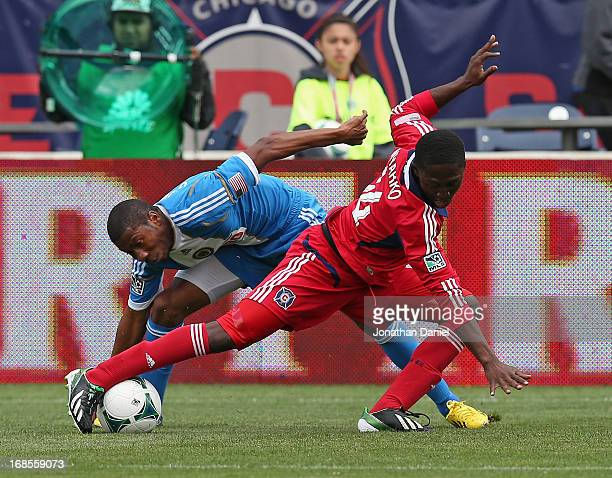 Patrick Nyarko of the Chicago Fire tries to control the ball under pressure from Raymon Gaddis of the Philadelphia Union during an MLS match at...