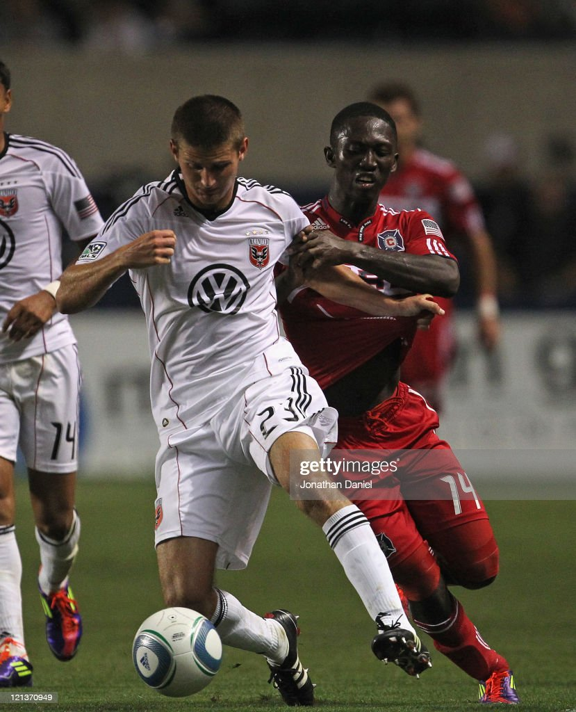 Patrick Nyarko of the Chicago Fire tries to hold back Perry Kitchen of DC United during an MLS match at Toyota Park on August 18 2011 in Bridgeview...