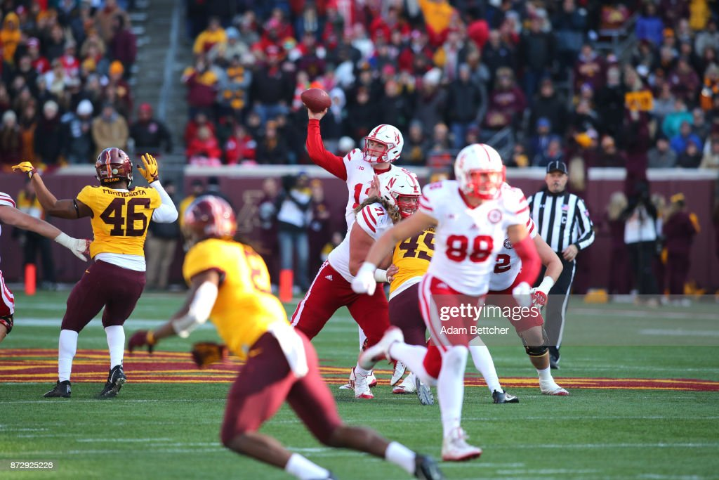 Patrick O'Brien #12 of the Nebraska Cornhuskers passes the ball for a first down in the third quarter against the Minnesota Golden Gophers at TCF Bank Stadium on November 11, 2017 in Minneapolis, Minnesota. Minnesota defeated Nebraska 54-21.