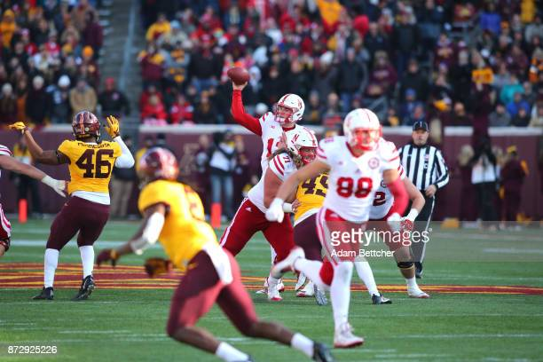 Patrick O'Brien of the Nebraska Cornhuskers passes the ball for a first down in the third quarter against the Minnesota Golden Gophers at TCF Bank...