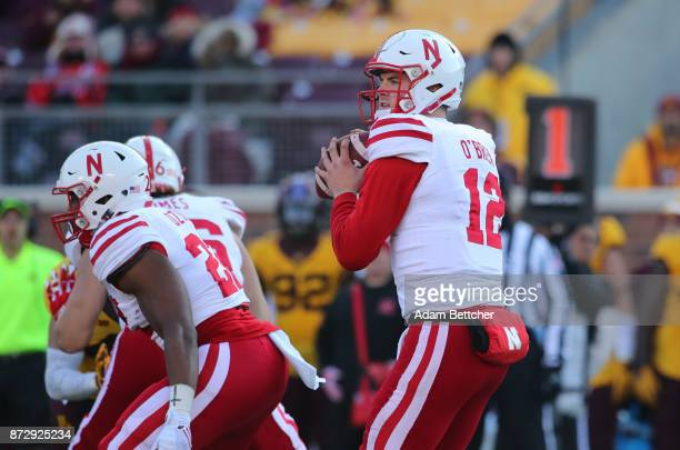 Patrick O'Brien of the Nebraska Cornhuskers takes the snap in the third quarter against the Minnesota Golden Gophers at TCF Bank Stadium on November...