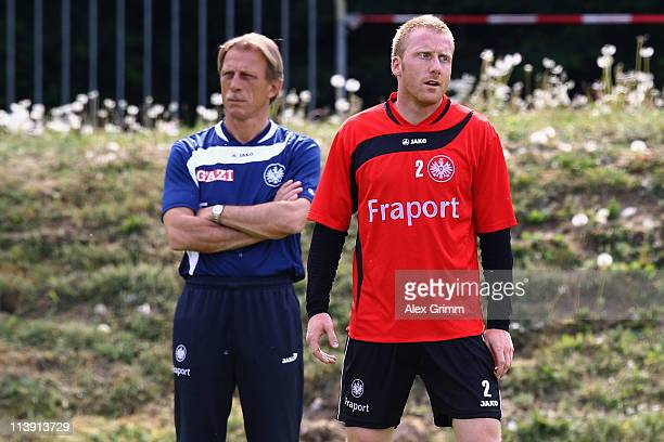 Patrick Ochs looks on as he stands in front of head coach Christoph Daum during a training session of Eintracht Frankfurt at Commerzbank Arena on May...