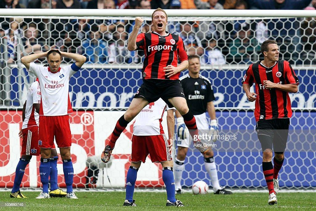 Patrick Ochs (C) of Frankfurt celebrates his team's first goal as Heiko Westermann (L) of Hamburg reacts during the Bundesliga match between Eintracht Frankfurt and Hamburger SV at the Commerzbank Arena on August 28, 2010 in Frankfurt am Main, Germany.