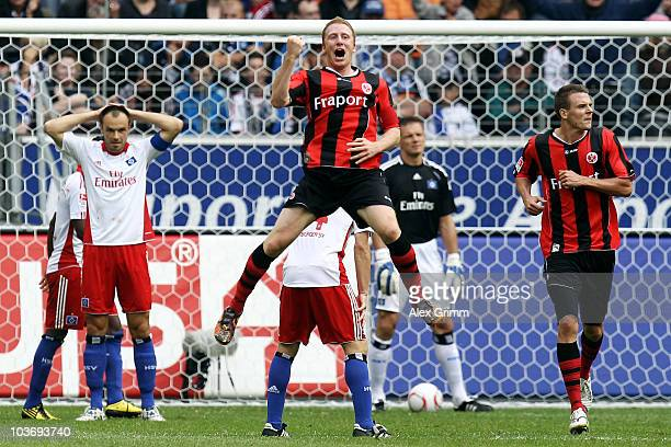 Patrick Ochs of Frankfurt celebrates his team's first goal as Heiko Westermann of Hamburg reacts during the Bundesliga match between Eintracht...