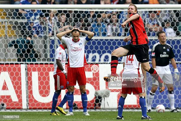 Patrick Ochs of Frankfurt celebrates his team's first goal as Heiko Westermann of Hamburg reacts during the Bundesliga match between Eintracht...