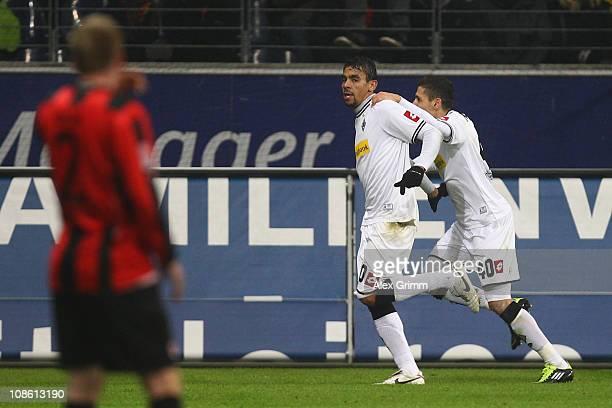 Patrick Ochs of Frankfurt reacts as De Camargo of M'Gladbach celebrates his team's first goal with team mate Karim Matmour during the Bundesliga...