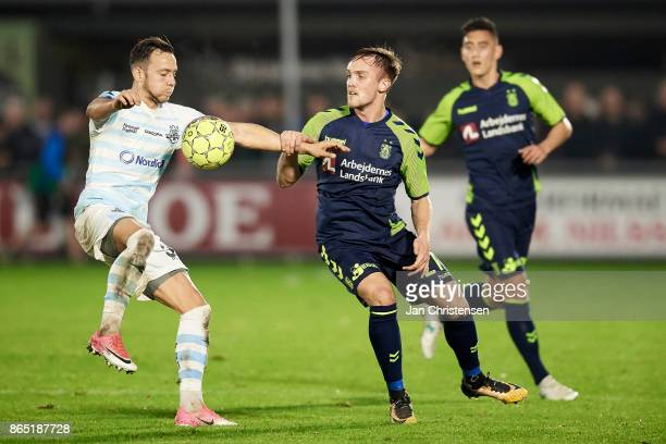 Patrick Olsen of FC Helsingor and Lasse Vigen Christensen of Brondby IF compete for the ball during the Danish Alka Superliga match between FC...