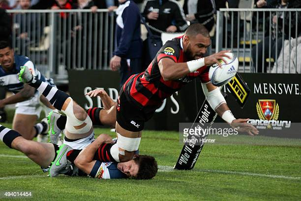 Patrick Osborne of Canterbury dives over to score a try in the tackle of Simon Hickey of Auckland during the ITM Cup Premiership Final between...