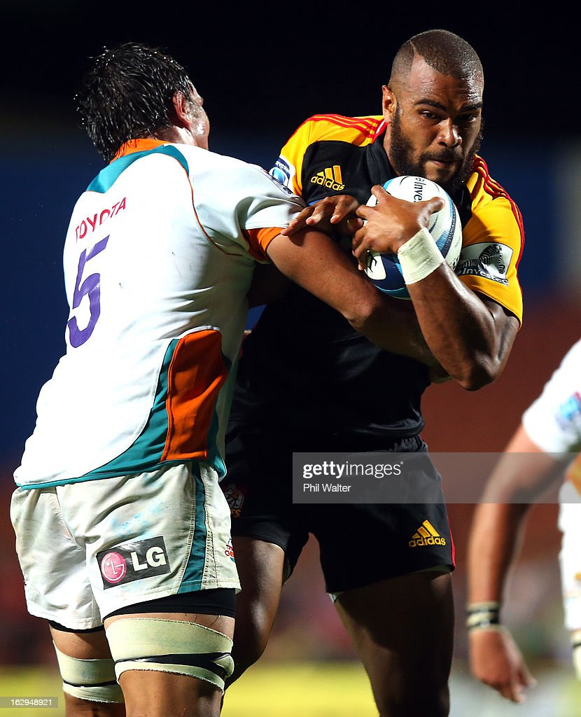 Patrick Osborne of the Chiefs is tackled by Hennie Daniller of the Cheetahs during the round three Super Rugby match between the Chiefs and the Cheetahs at Waikato Stadium on March 2, 2013 in Hamilton, New Zealand.