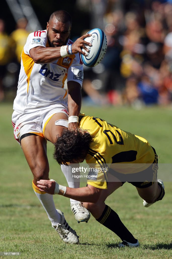 Patrick Osborne of the Chiefs is tackled by Richard Buckman of the Hurricanes during the Super Rugby trial match between the Hurricanes and the Chiefs at Mangatainoka RFC on February 16, 2013 in Mangatainoka, New Zealand.