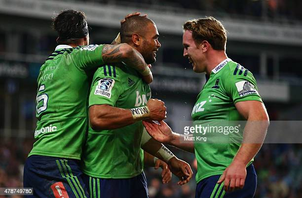 Patrick Osborne of the Highlanders celebrates with team mates after scoring the final try during the Super Rugby Semi Final match between the...