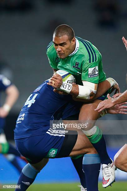 Patrick Osborne of the Highlanders ia tackled during the round 18 Super Rugby match between the Blues and the Highlanders at Eden Park on June 12...