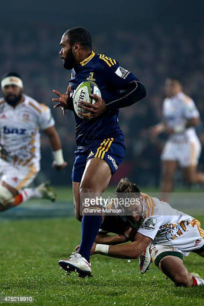 Patrick Osborne of the Highlanders in the tackle of Marty McKenzie of the Chiefs during the round 16 Super Rugby match between the Highlanders and...