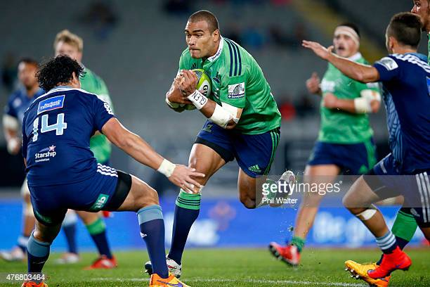 Patrick Osborne of the Highlanders is tackled during the round 18 Super Rugby match between the Blues and the Highlanders at Eden Park on June 12...