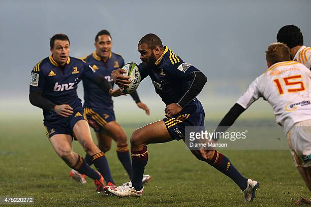 Patrick Osborne of the Highlanders makes a break during the round 16 Super Rugby match between the Highlanders and the Chiefs at Rugby Park Stadium...