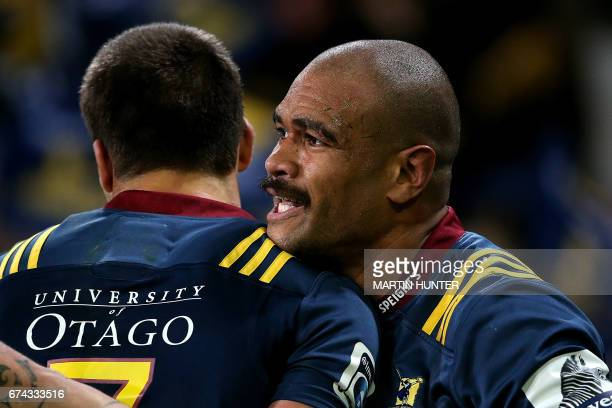 Patrick Osborne of the Otago Highlanders celebrates with teammate after scoring a try during the Super Rugby match between the Otago Highlanders of...