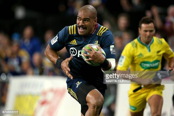 Patrick Osborne of the Otago Highlanders makes away to score a try during the Super Rugby match between the Otago Highlanders of New Zealand and the...