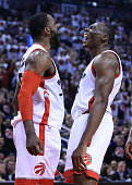 Patrick Patterson and Bismack Biyombo of the Toronto Raptors celebrate a basket in Game Seven of the Eastern Conference Quarterfinals against the...