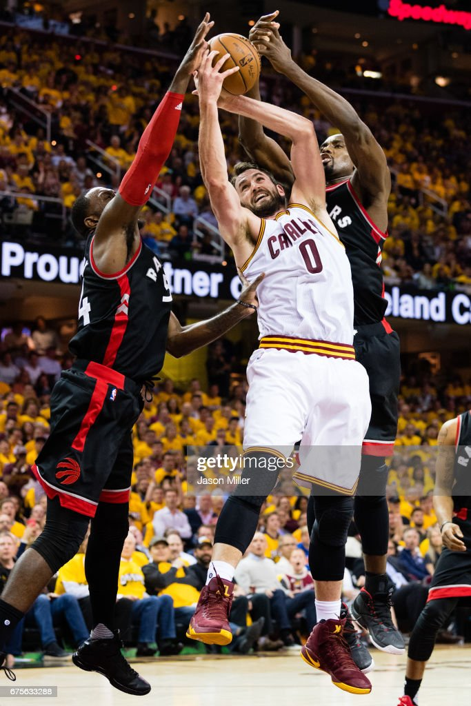 Patrick Patterson #54 and Serge Ibaka #9 of the Toronto Raptors fight Kevin Love #0 of the Cleveland Cavaliers for a rebound during the second half of Game One of the NBA Eastern Conference semifinals at Quicken Loans Arena on May 1, 2017 in Cleveland, Ohio. The Cavaliers defeated the Raptors 116-105.