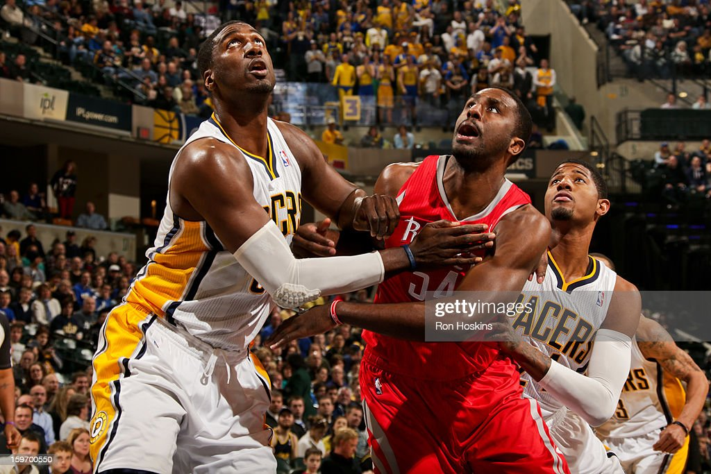 Patrick Patterson #54 of the Houston Rockets battles for rebound position against Roy Hibbert #55 and Paul George #24 of the Indiana Pacers on January 18, 2013 at Bankers Life Fieldhouse in Indianapolis, Indiana.