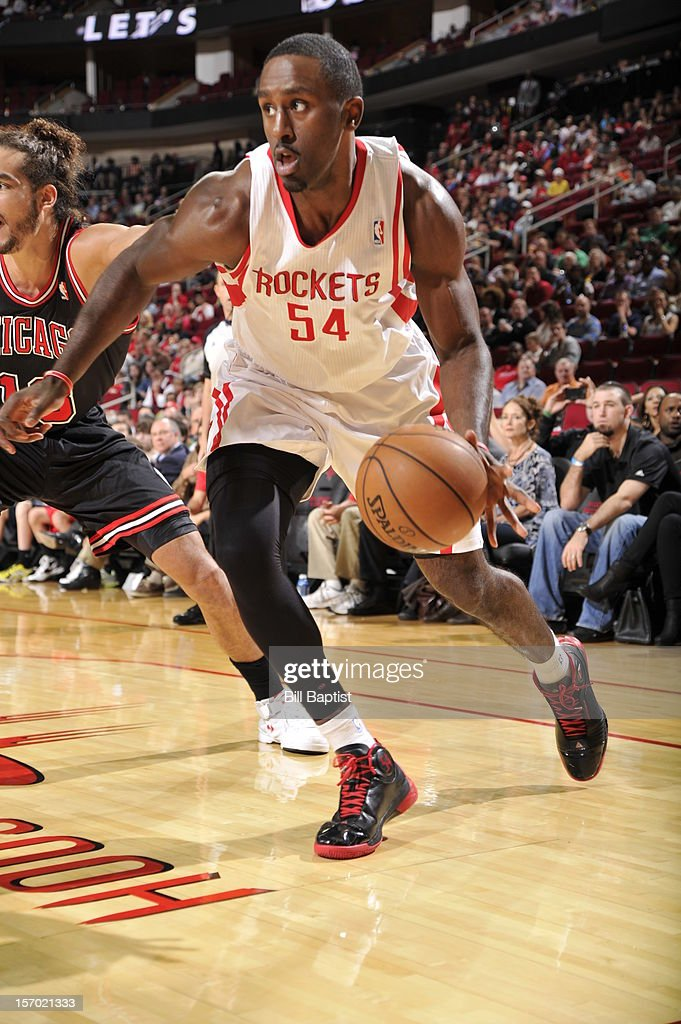 Patrick Patterson #54 of the Houston Rockets drives to the basket against Joakim Noah #13 of the Chicago Bulls on November 21, 2012 at the Toyota Center in Houston, Texas.