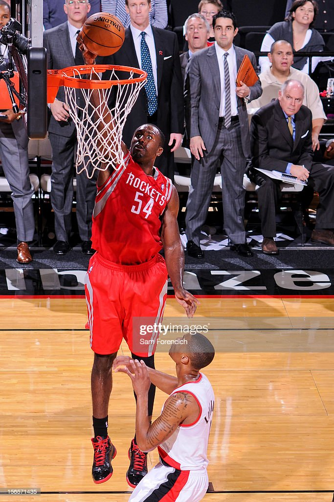 <a gi-track='captionPersonalityLinkClicked' href=/galleries/search?phrase=Patrick+Patterson&family=editorial&specificpeople=2928099 ng-click='$event.stopPropagation()'>Patrick Patterson</a> #54 of the Houston Rockets dunks against the Portland Trail Blazers on November 16, 2012 at the Rose Garden Arena in Portland, Oregon.