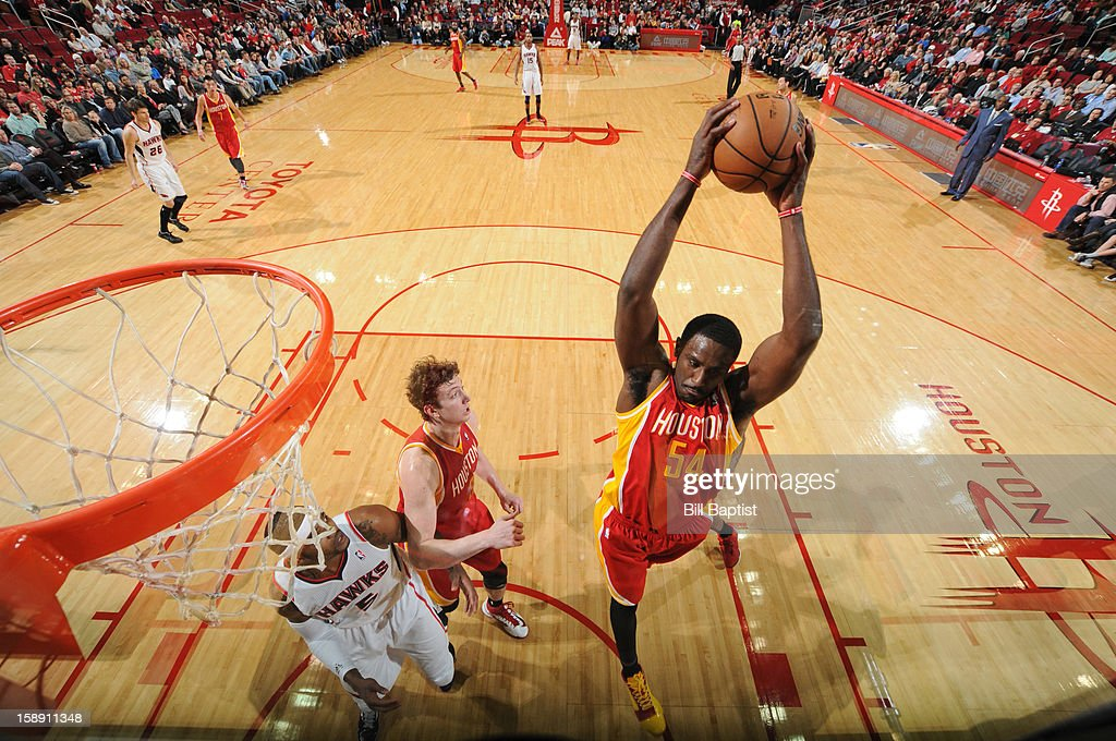 Patrick Patterson #54 of the Houston Rockets grabsa a rebound against the Atlanta Hawks on December 31, 2012 at the Toyota Center in Houston, Texas.
