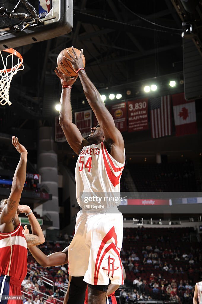 Patrick Patterson #54 of the Houston Rockets rebounds the ball against the Washington Wizards on December 12, 2012 at the Toyota Center in Houston, Texas.