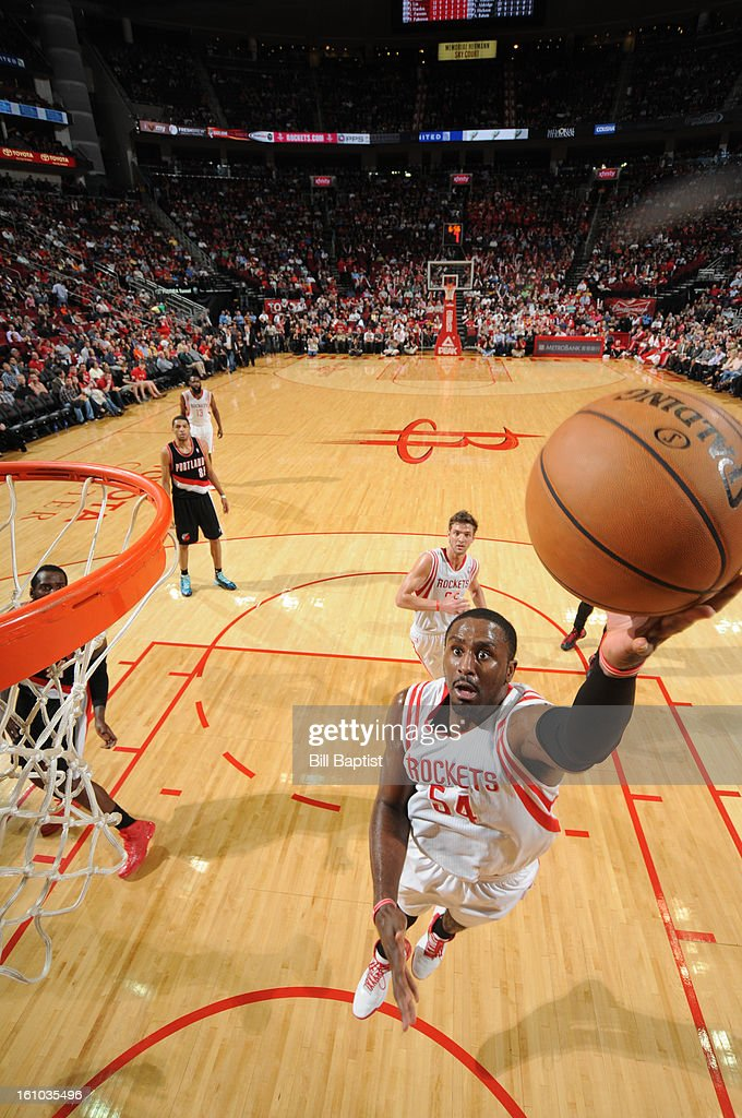 <a gi-track='captionPersonalityLinkClicked' href=/galleries/search?phrase=Patrick+Patterson&family=editorial&specificpeople=2928099 ng-click='$event.stopPropagation()'>Patrick Patterson</a> #54 of the Houston Rockets shoots a layup against the Portland Trail Blazers on February 8, 2013 at the Toyota Center in Houston, Texas.
